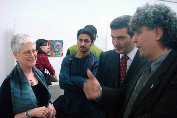 """Explaining her works to the Dean of the Faculty of Fine Art, Minia University, Egypt"""