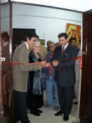 "Thumbnail image of ""Cutting the ribbon to open my solo exhibition, Minia University, Egypt"""