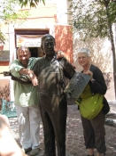 "Thumbnail image of ""Karen and Hugo Anaya with statue of Diego Riviera, Guanajuato, Mexico"""
