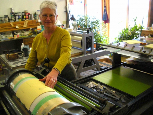 """Karen at her press, printing text pages for Ten Thousand Things project, fall"""
